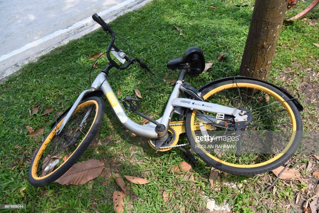 A Bicycle Owned By Bike Sharing Company Obike Is Seen Left Along The Roadside In