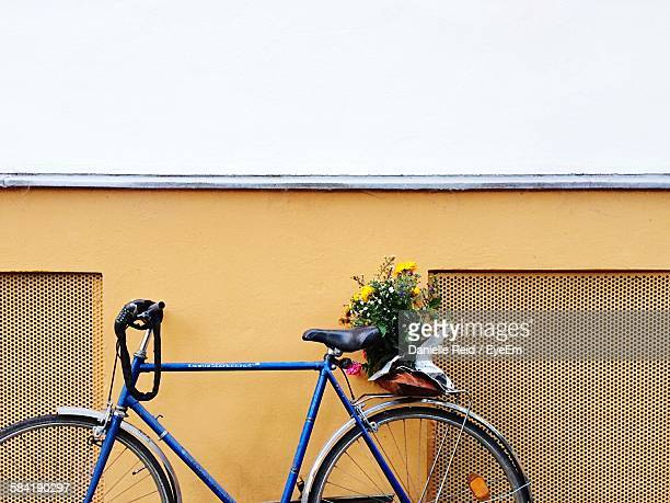 Bicycle Parked Against Building