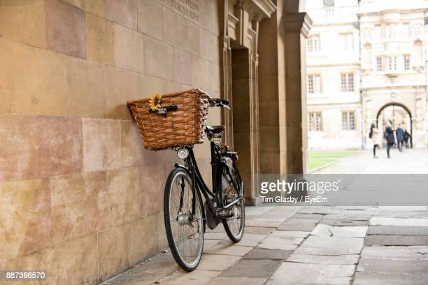 bicycle parked by building in city - cambridge england stock pictures, royalty-free photos & images