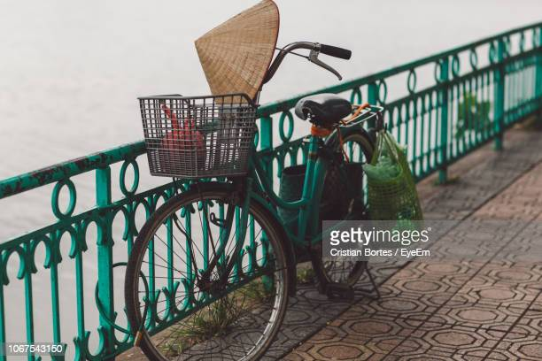 Bicycle Parked By Railing On Footpath