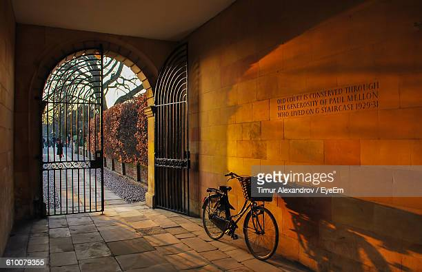 bicycle parked in archway - cambridge england stock pictures, royalty-free photos & images
