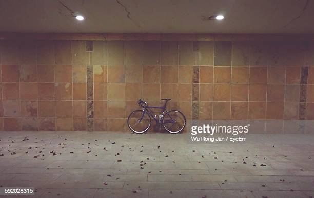 Bicycle Parked In Illuminated Basement