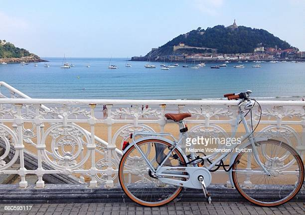 bicycle parked on footbridge against sea - san sebastian spain stock pictures, royalty-free photos & images