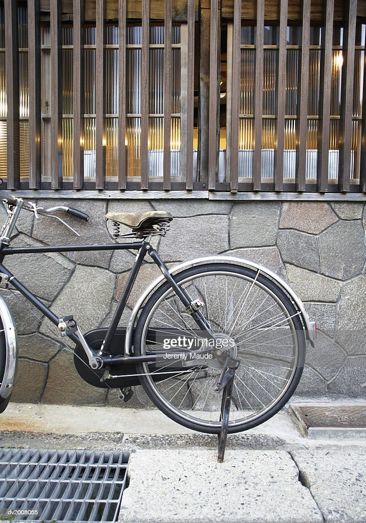 Bicycle Parked on the Pavement, Japan : Stock Photo