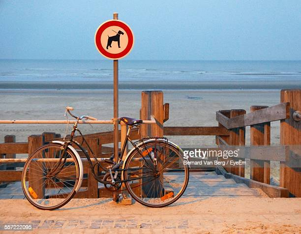 Bicycle Parking Against Dog Leash Sign