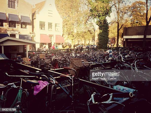 bicycle parking lot against house in city - zwolle stock photos and pictures