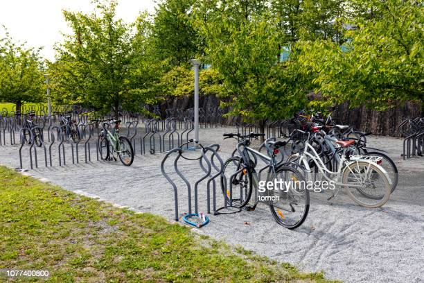 bicycle parking - bicycle parking station stock photos and pictures