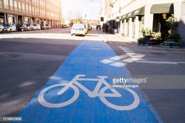 bicycle path on the road, copenhagen, denmark - copenhagen stock pictures, royalty-free photos & images