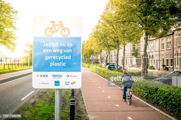 bicycle path plasticroad made out of recycled plastics in zwolle, the netherlands. - social awareness symbol stock photos and pictures