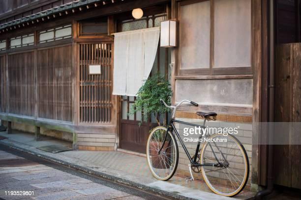 a bicycle - のれん ストックフォトと画像