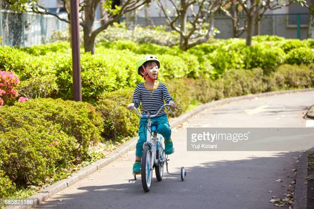 bicycle practice - tricycle stock pictures, royalty-free photos & images