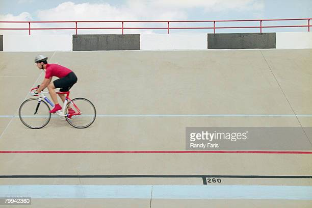 Bicycle Racer Riding on Track