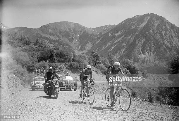Bicycle racers Fausto Coppi followed by Andre Buchonnet in the 20th stage of the 1951 Tour de France They left the rest of the group in Izoard's Pass...