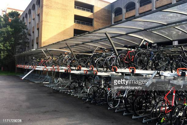 bicycle rack at reading station - stevebphotography stock pictures, royalty-free photos & images