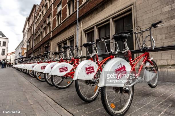 bicycle rental system in antwerp belgium-europe - antwerp city belgium stock pictures, royalty-free photos & images