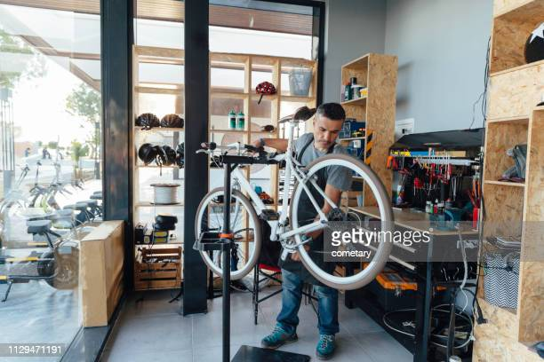 bicycle repair - bicycle shop stock pictures, royalty-free photos & images