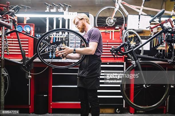 Bicycle Repair Shop and Man Working