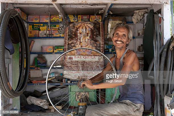 bicycle repairman - hugh sitton stock pictures, royalty-free photos & images