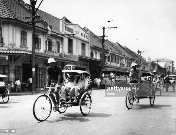 Bicycle Rickshaws on the streets of Bangkok Thailand