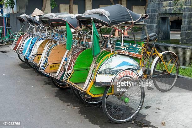 Bicycle Rickshaws Parked in Yogyakarta Java Indonesia Street