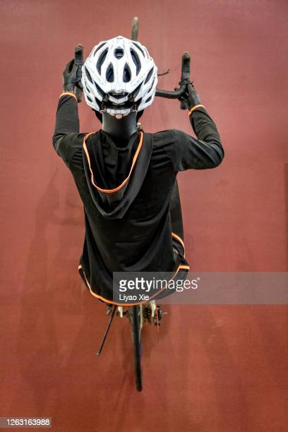 bicycle rider dummy - liyao xie stock pictures, royalty-free photos & images