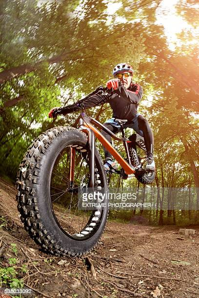 Bicycle rider in the woods