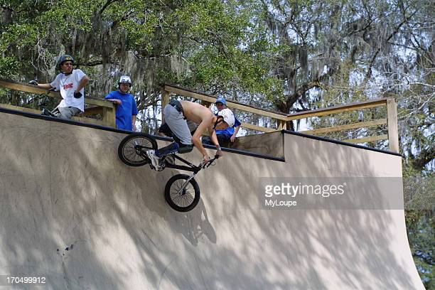 BMX Bicycle Rider Performing Maneuvers In BMX Park In Ocala Florida USA