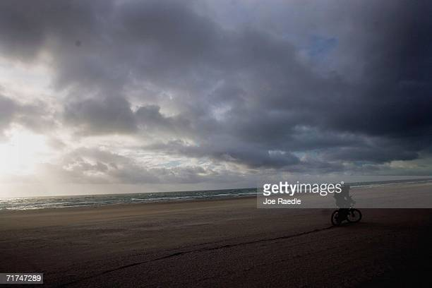A bicycle rider rides into the blowing winds generated by the remains of Tropical Storm Ernesto August 30 2006 in Miami Beach Florida So far the...