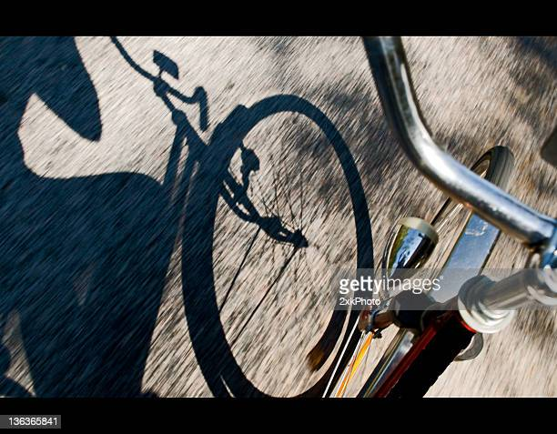 bicycle rider with shadow