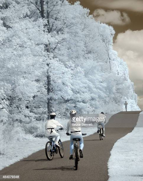 Bicycle riders bike through the Bethpage Bikeway on August 23 2014 in Bethpage New York