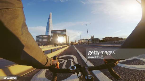 pov bicycle riding: commuter with road racing bike in london - riding stock pictures, royalty-free photos & images