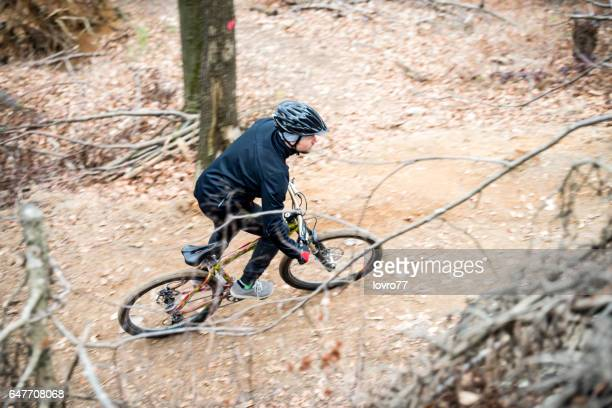 Bicycle riding in beautiful forest at autumn