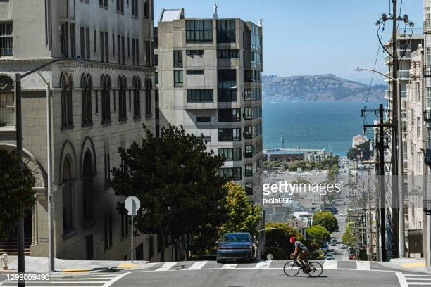 bicycle riding in san francisco: commuter with racing bicycle - north beach san francisco stock pictures, royalty-free photos & images