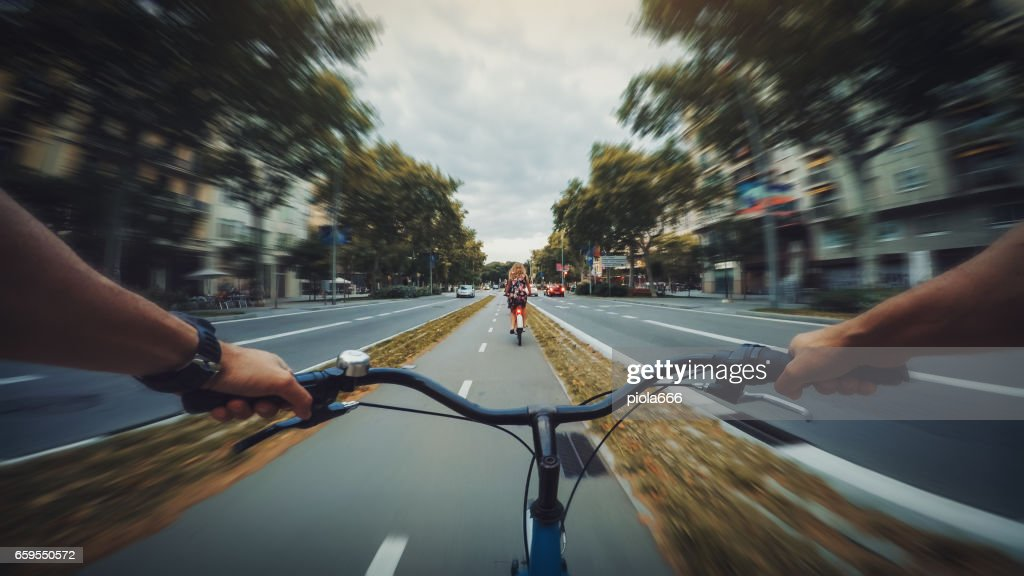 POV bicycle riding in the city, Barcelona, Spain : Stock Photo