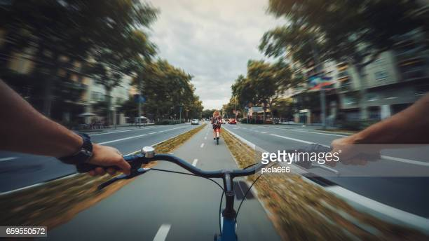 pov bicycle riding in the city, barcelona, spain - handlebar stock photos and pictures