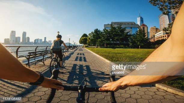 pov bicycle riding: man with road racing bike in new york - jersey city stock pictures, royalty-free photos & images
