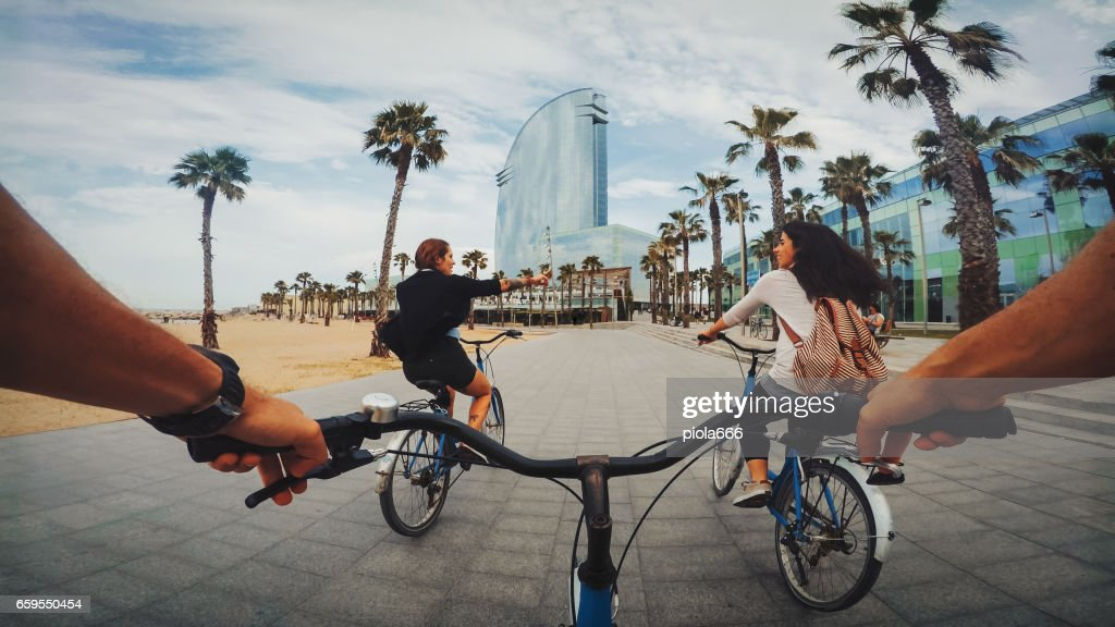 POV bicycle riding with friends at Barceloneta beach in Barcelona, Spain : Foto de stock