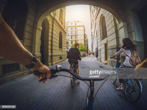 pov bicycle riding with friends in barcelona, spain - handlebar stock photos and pictures