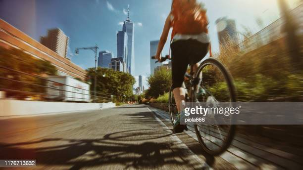 pov bicycle riding: woman with road bike in new york - action movie stock pictures, royalty-free photos & images