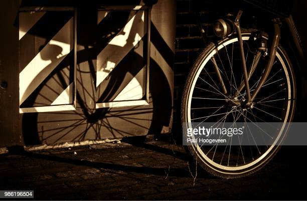 bicycle shadows - hoogeveen stock pictures, royalty-free photos & images