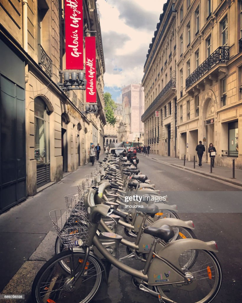 Bicycle sharing system bikes parked on Paris street, France : Stock Photo