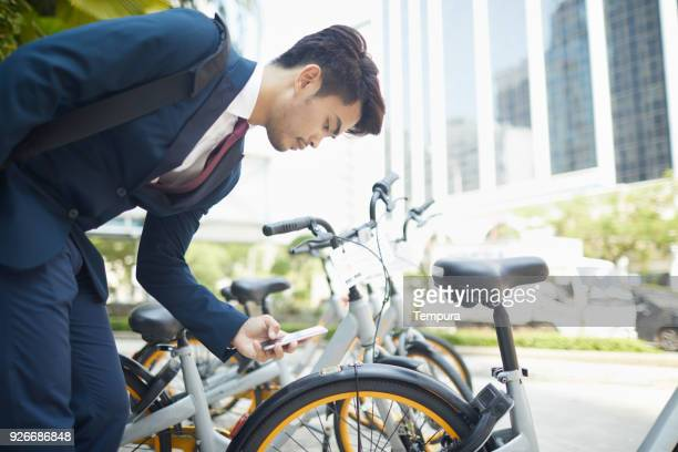 bicycle sharing system in kuala lumpur smart city. - bicycle parking station stock photos and pictures