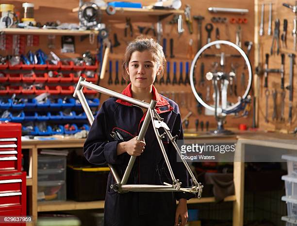 bicycle shop owner in workshop. - bicycle shop stock pictures, royalty-free photos & images