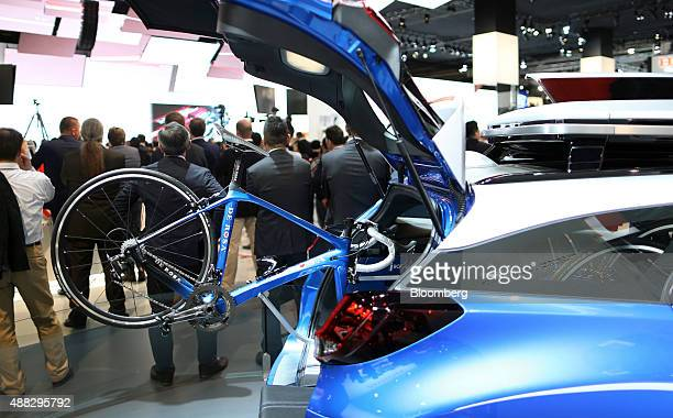 A bicycle sits in the trunk of a Honda Civic Tourer Active Life Concept automobile produced by Honda Motor Co at the IAA Frankfurt Motor Show in...