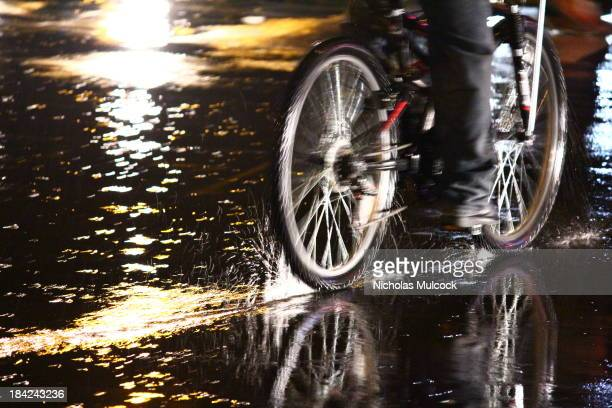 CONTENT] Bicycle splashing through the rain