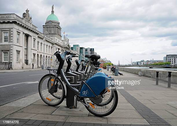 Bicycle stand for Dublin Bikes, a public bicycle rental scheme in central Dublin. Location: Custom House Quay, beside the River Liffey. The domed...