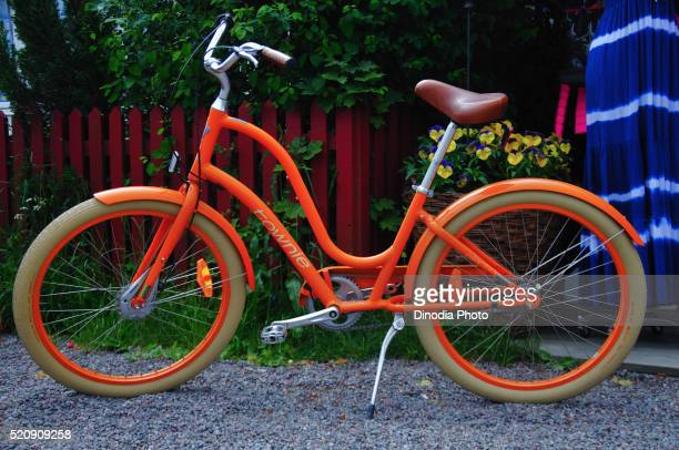 bicycle standing on footpath sandhamn, archipelago, sweden - nissan stock pictures, royalty-free photos & images