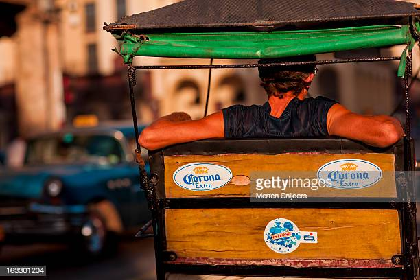 bicycle taxi driver relaxing in backseat - merten snijders stock pictures, royalty-free photos & images