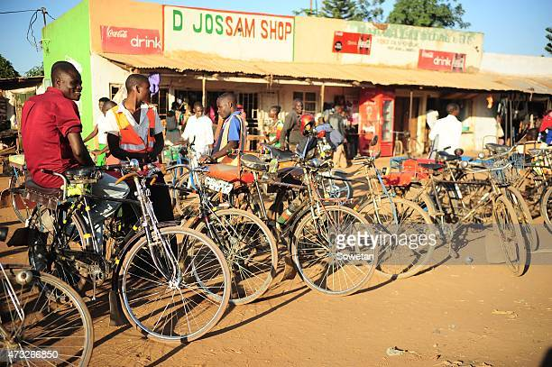 Bicycle taxi drivers wait for passengers in Mponela Village on May 6 2015 in Malawi Bicycle taxis known as kabazas in Chichewa are a cheaper form of...