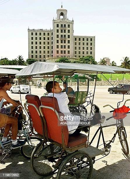 Bicycle taxi drivers wait for tourists at the Hotel Nacional 03 June 1999 in Havana Varios conductores de bicitaxis aguardan por turistas en las...